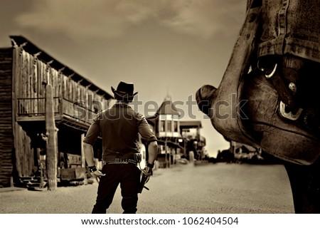 vintage cowboy in old wild far west ghost town