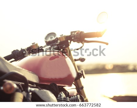 Vintage custom cafe racer motorcycle in the  sunset. motorbike. Outdoors. #663772582