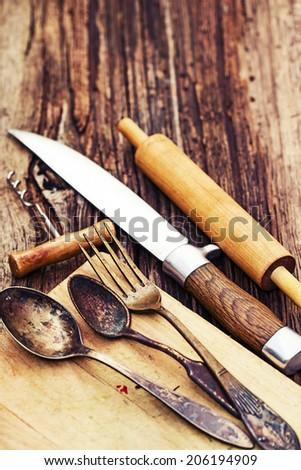 Vintage cutlery on rustic wooden background/ Vintage Kitchen Utensils for cooking
