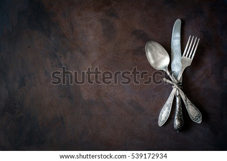 Vintage cutlery / silverware on dark background with copy space for text