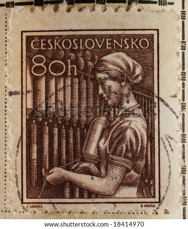 Vintage Czechoslovakian postage stamp with female worker - stock photo