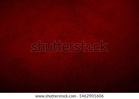 Vintage dark red wall texture for design background. Artistic plaster. Artistic gradient. Illuminated surface. Raster image.