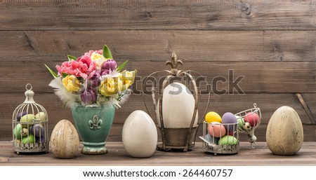 Vintage decoration with tulip flowers and easter eggs. Retro style toned picture