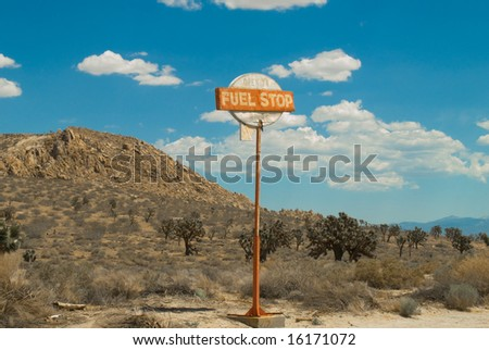 Vintage Desert Fuel Stop Sign on Highway - stock photo