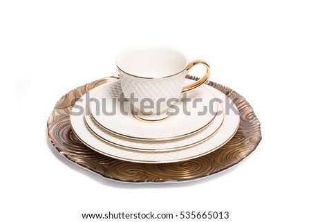 Vintage dishes and a cup isolated on white background #535665013