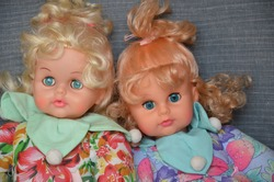 vintage doll with big blue eyes and yellow hair