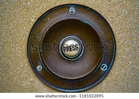 Vintage doorbell. Old brass button