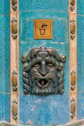 Vintage drinking water fountain in a bath in Budapest