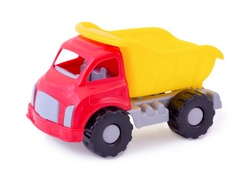 Vintage dump truck isolated on white background wih shadow reflection. Plastic child toy on white backdrop. Dump tipper truck lorry construction vehicle. Plastic children's toy. Kid's plaything.