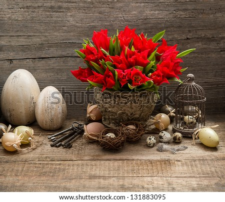 vintage easter decoration with eggs and red tulip flowers. nostalgic still life home interior