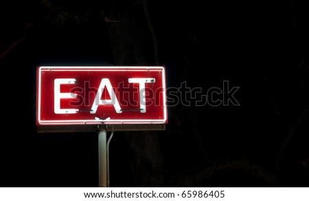 Vintage 'EAT' sign. - stock photo