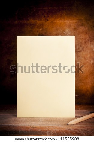 Vintage envelope background with pencil on a dark grunge background in shallow focus