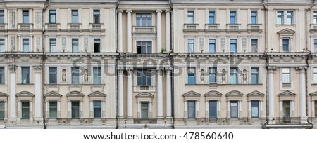 Vintage facade classical building. Columns,balconies,fences,niches,vases, small caps,stucco,pilasters,pediments and other  architectural decoration of the Baroque style and the Beaux-Arts style. Front
