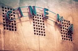 Vintage Facade of old cinema in Bucharest Romania, with cinema written