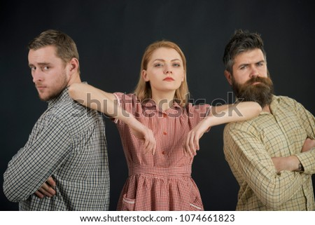 Vintage fashion concept. Men and woman on pensive faces on black background. Men in checkered clothes, retro style. Company of confident people, friends. Relations, communication, friendship, love.