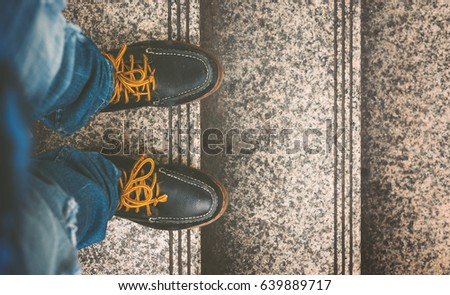 Vintage Fashion of a Man Wearing Blue Jeans and Leather Shoes on the Staircase