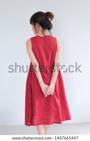 937f5709c339 Vintage Fashion Portrait of Young asian woman with bun hair style wearing red  dress linen clothing
