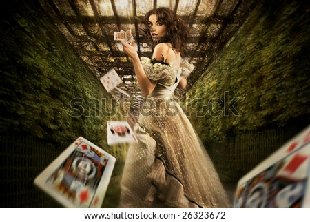 Vintage female magician throwing playing cards