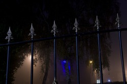 Vintage fence during foggy night Manchester England Europe