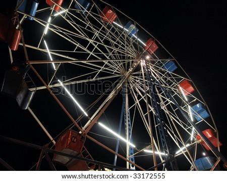 Vintage Ferris Wheel in a traveling carnival.
