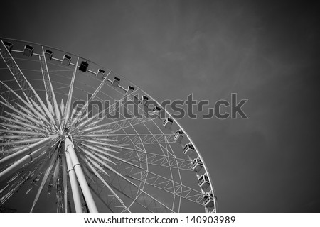 Vintage Ferris Wheel Over Turquoise Sky. Black and white photo.