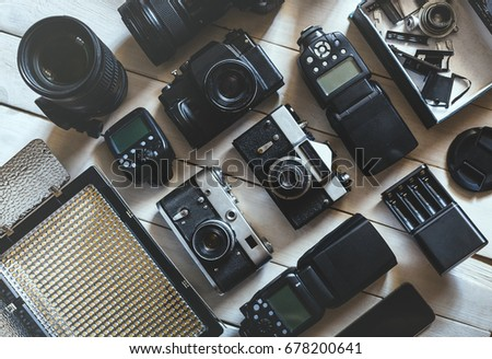 Vintage Film Camera, DSLR Digital Camera And Accessories On White Wooden Background Technology Development Concept. Top View