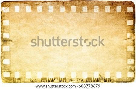 Vintage film strip frame on old and damaged paper background.