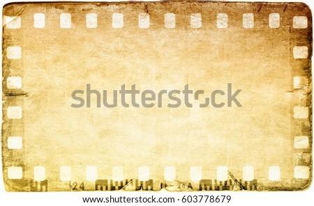 Vintage film strip frame on old and damaged paper background.