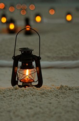 Vintage Fire Lanterns with Blurred Bokeh Backgrounds