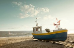 Vintage fisherman boat on the beach at Baltic sea