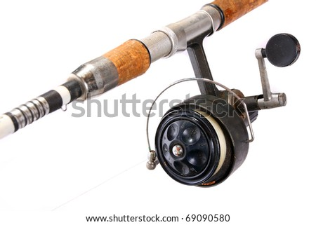 Vintage fishing rod with reel.
