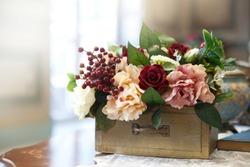 Vintage floral arrangement of roses and peonies.