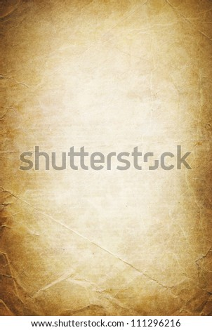 Vintage folded and torn old paper. Grunge classic background