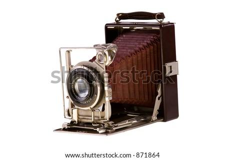 Vintage folding camera isolated on white background