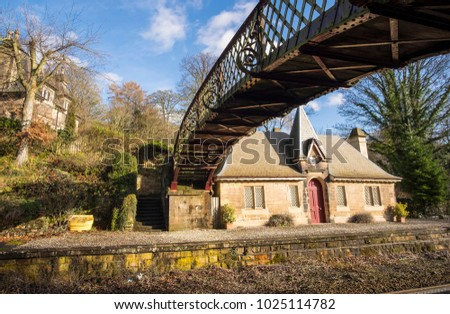 Vintage footbridge and platform at Cromford railway station, Derbyshire, UK