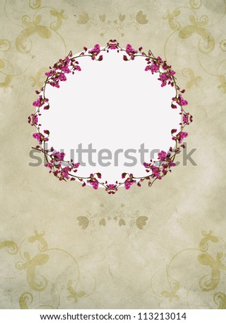 Vintage frame from floral ornaments on the grunge background. Hand-drawn material and a photo of flowers.