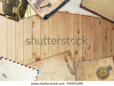 Vintage frame with old paper and book, retro composition on wooden background