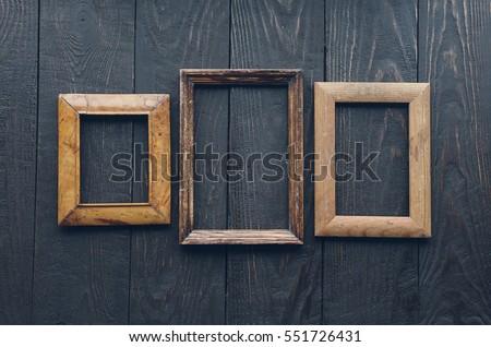 vintage frames on old wooden...