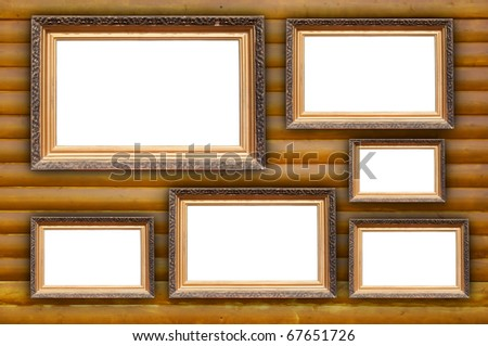 Vintage Frames on Wooden Wall - stock photo