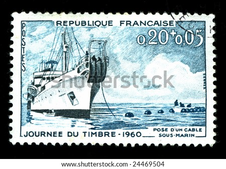 vintage french stamp depicting a cable laying ship