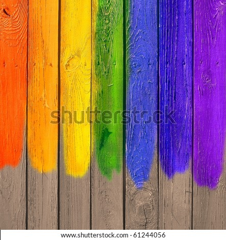 Vintage Gallery: Grunge wooden colored background - rainbow paints on old fence