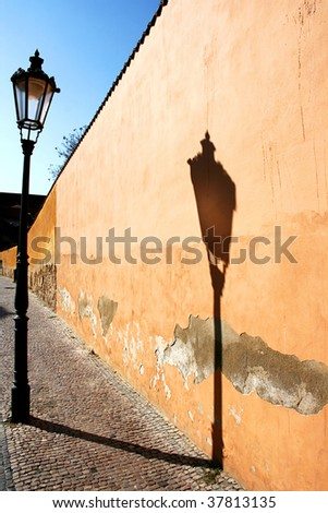 Vintage gas-lamp reflecting on the wall