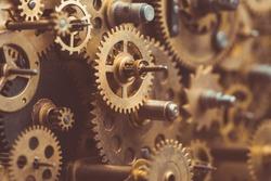 Vintage gears and cogs in mechanism macro