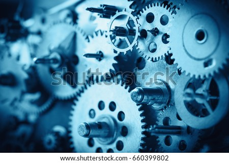 Vintage gears and cogs macro blue color toned