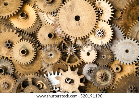 Vintage gears macro view. Aged mechanical clock wheels background. Shallow depth of field, soft focus
