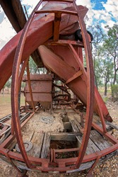 Vintage gem prospecting mine equipment on the back of an old abandoned truck, fish eye lens
