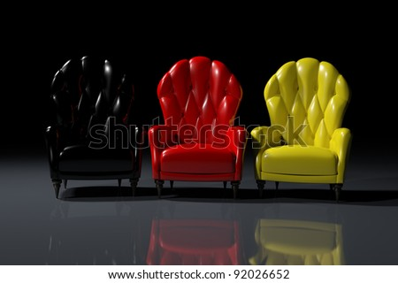 Vintage German color armchairs on black background