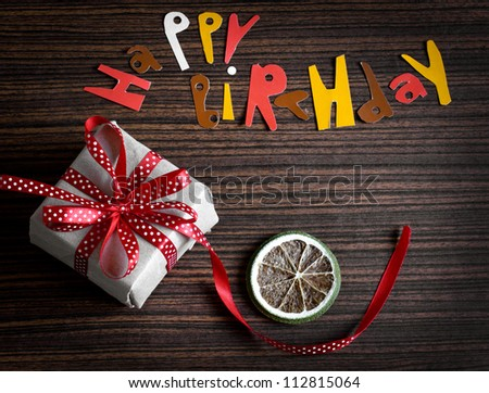 Vintage gift box (package)with words happy birthday on  wooden background/holiday background.