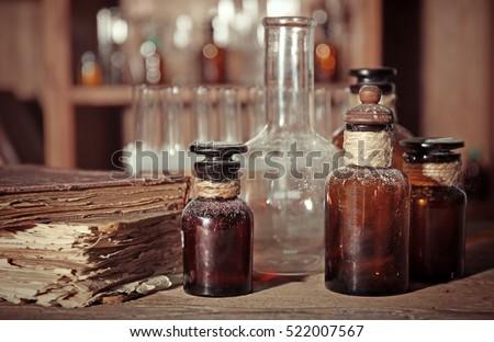 vintage glass bottles on wooden ...