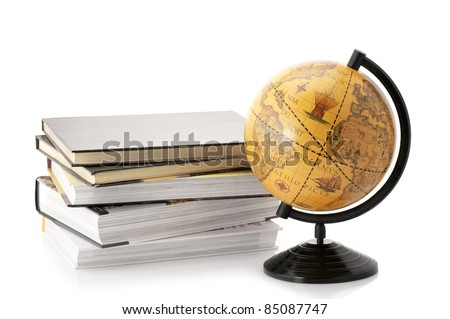 Vintage globe and stack of books isolated on white background.